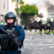 Image of street with police officer in riot gear
